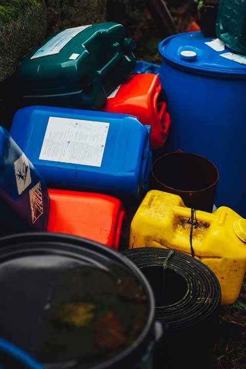 Empty gas cans and barrels, Horizon Environmental Hazardous Material Services