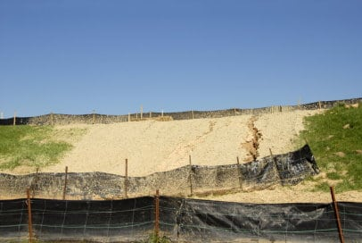 Erosion Control, dirt hill with silt fencing, construction site